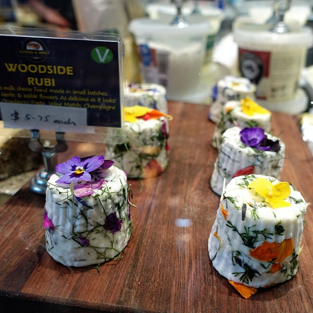 Hand made goat's milk cheese that has been decorated with edible flowers! Too pretty to eat.... #queenvictoriamarket #melbourne